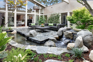 Courtyard with waterfall and pond.