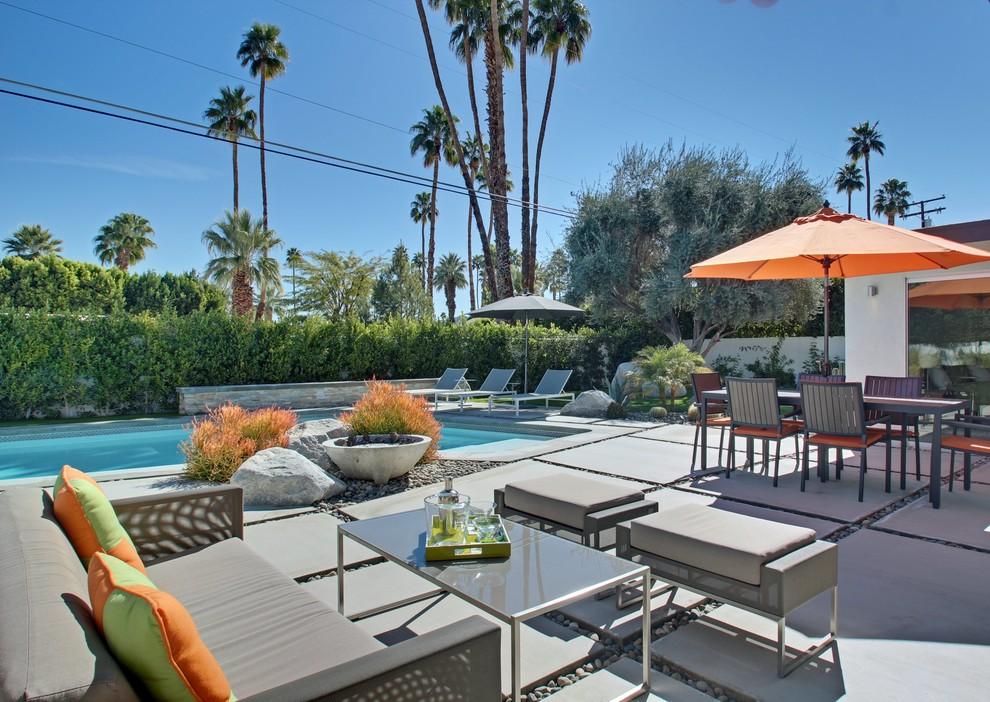 Patio - large backyard concrete paver patio idea in Los Angeles