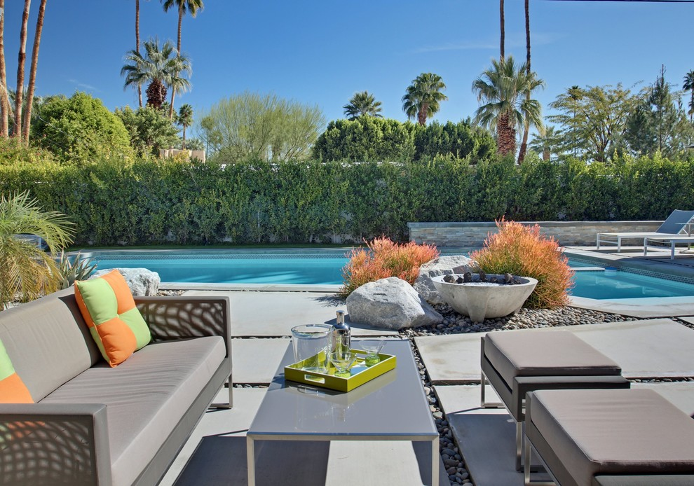 Patio - large mid-century modern backyard concrete paver patio idea in Los Angeles