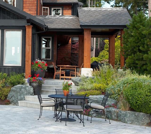 Waterside patio. rustic-patio