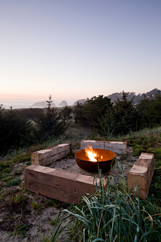 Inspiration for a beach style patio remodel in Portland with a fire pit