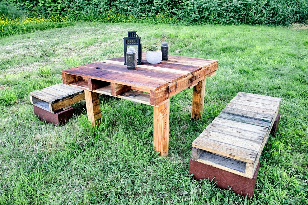 Inspiration for a rustic patio remodel in Seattle with no cover
