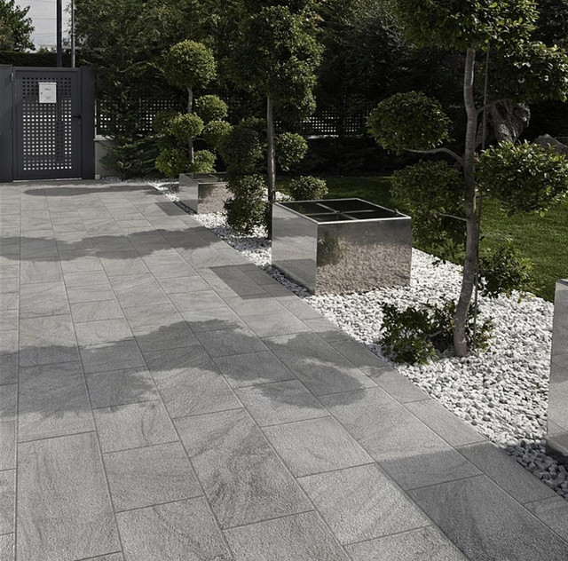 Example Of A Large Trendy Backyard Tile Patio Design In San Francisco With Roof Extension