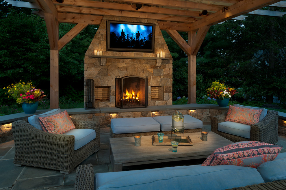 Patio - contemporary patio idea in New York with a fireplace