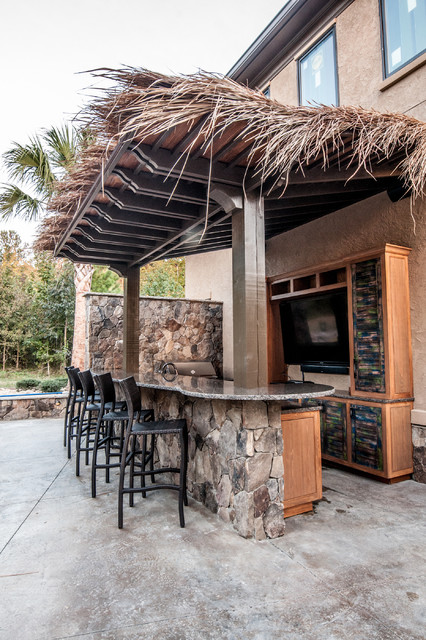Outdoor bar and kitchen tiki theme for Tropical themed kitchen