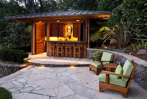8 outdoor tiki bars that make us want to hula dance. Black Bedroom Furniture Sets. Home Design Ideas