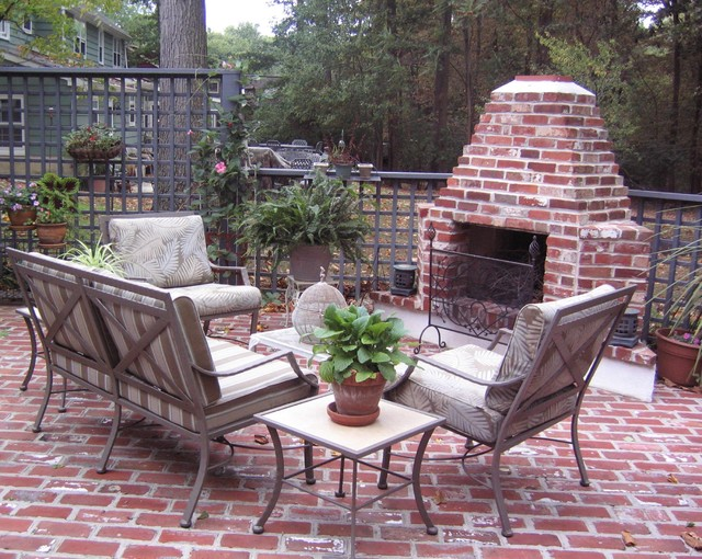 Outdoor brick  fireplace eclectic patio