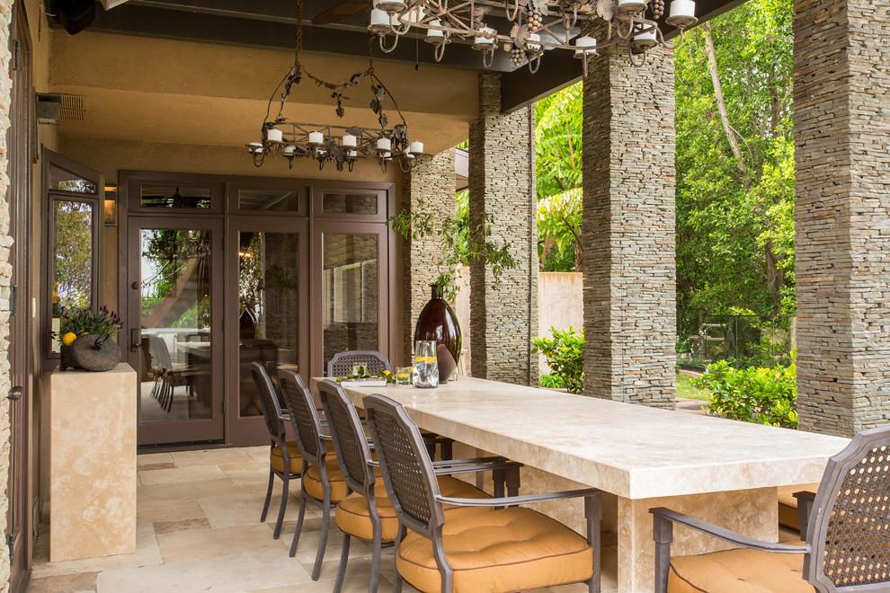 Patio - huge mediterranean backyard tile patio idea in Los Angeles