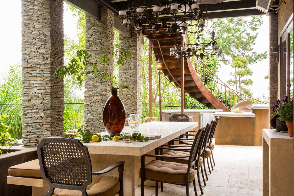 Inspiration for a large mediterranean backyard tile patio kitchen remodel in Los Angeles