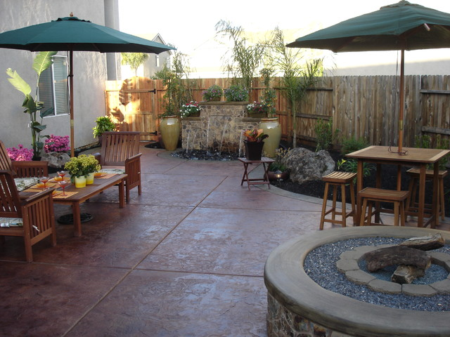 Outdoor Entertaining Area with Fountain and Fire Pit - traditional