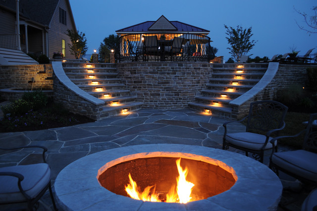 Outdoor fire-pit and path-lit double stone staircase traditional-patio