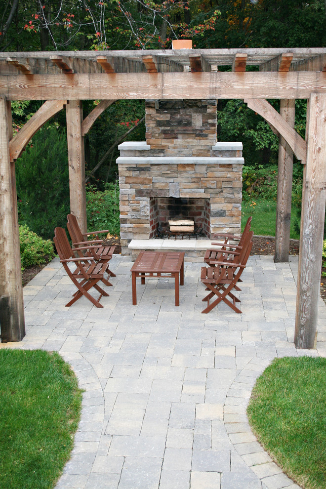 Patio - traditional patio idea in Grand Rapids with a fire pit and a pergola