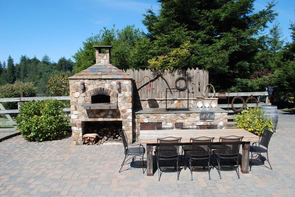 Elegant concrete paver patio photo in San Francisco with a fire pit and no cover
