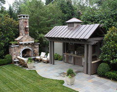 Outdoor kitchen and Fireplace traditional-patio