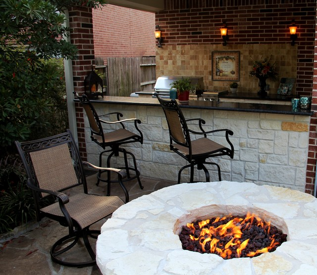 Outdoor kitchen fire feature and stamp overlay in humble for Tradition outdoor living