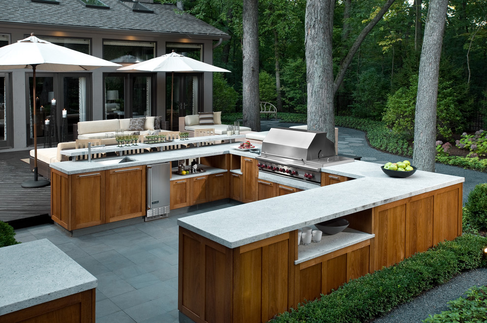 Example of a large trendy backyard tile patio kitchen design in Chicago with no cover