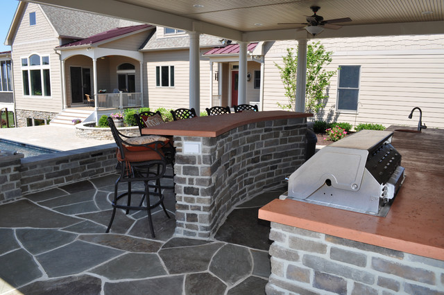 Outdoor kitchen inside pool house traditional patio for Traditional outdoor kitchen designs