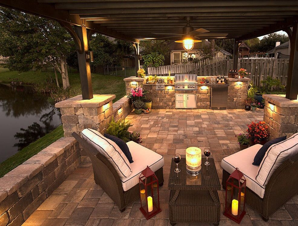 Mid-sized elegant backyard concrete paver patio kitchen photo in Tampa with a gazebo