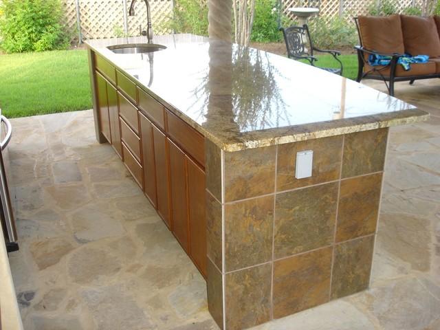 outdoor kitchen tile back splash bar tile granite counter tropical