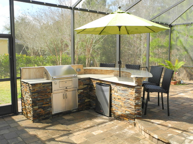Outdoor Kitchen with curved bar and charcoal grill
