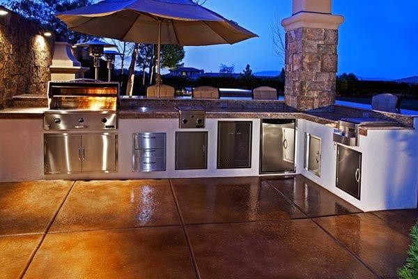 Outdoor Kitchen with Custom Tile Design traditional-patio