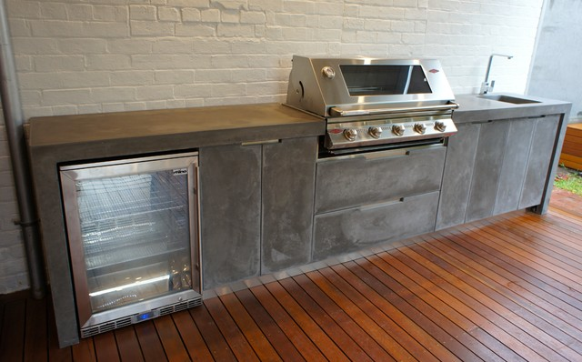outdoor kitchen with polished concrete bench top doors