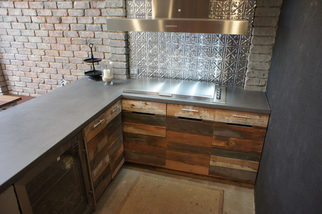 Outdoor Kitchen With Polished Concrete Bench Tops And Reclaimed Timber Doors