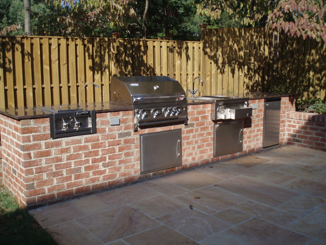 Outdoor Kitchen With Privacy Fence And Stone Patio Traditional Patio