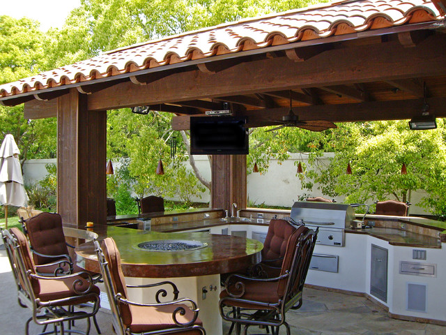 Outdoor Kitchen With Round Table And Pergola