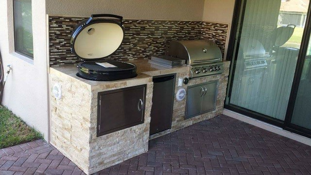 Outdoor Kitchen with Stacked Stone Exterior and Primo Oval ...