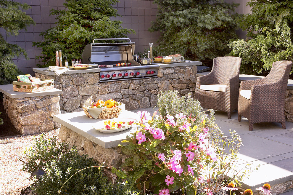 Patio - mid-sized transitional backyard stone patio idea in Boston with no cover