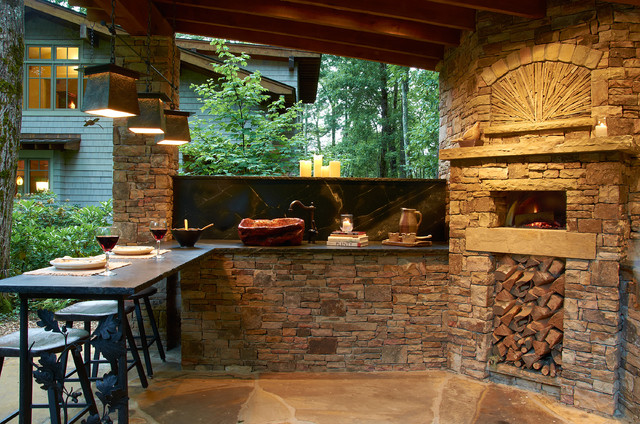 Outdoor kitchen with wood burning pizza oven rustic for Outdoor kitchen builders near me