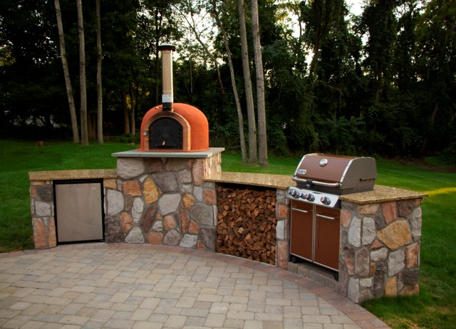 outdoor kitchen with wood fired pizza oven