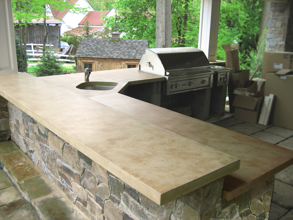 Example of a mid-sized classic backyard patio kitchen design in New York