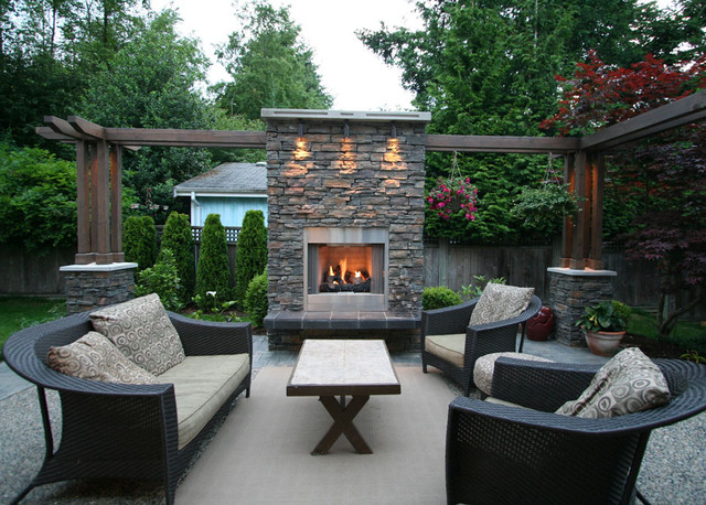 Large Trendy Backyard Stamped Concrete Patio Photo In Vancouver With A Fire Pit