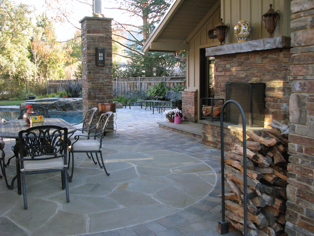 outdoor living area with masonry fireplace eclectic patio
