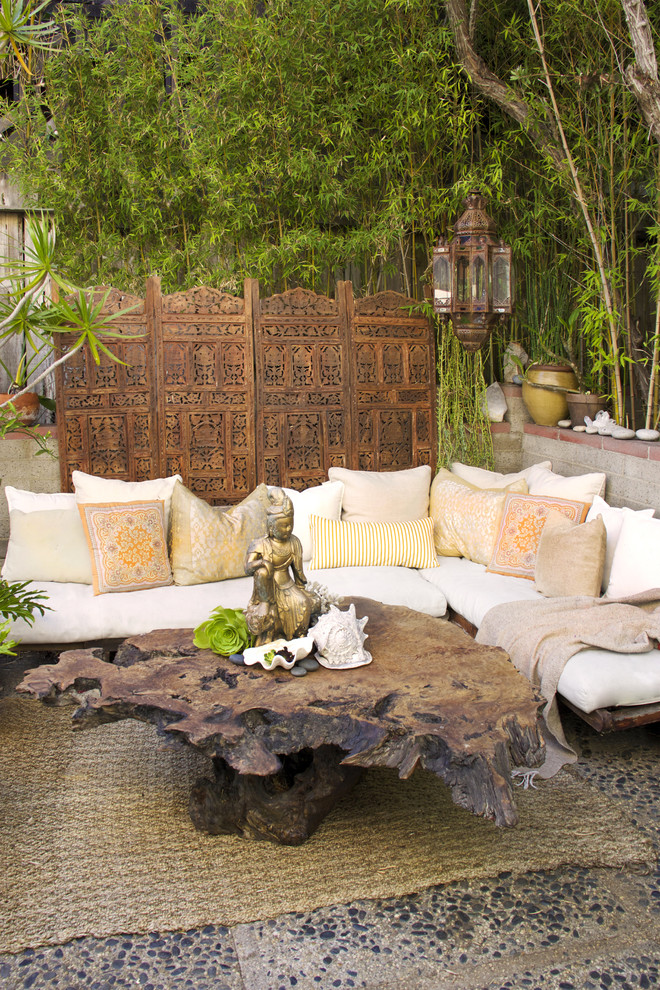 Patio - small eclectic courtyard patio idea in Orange County
