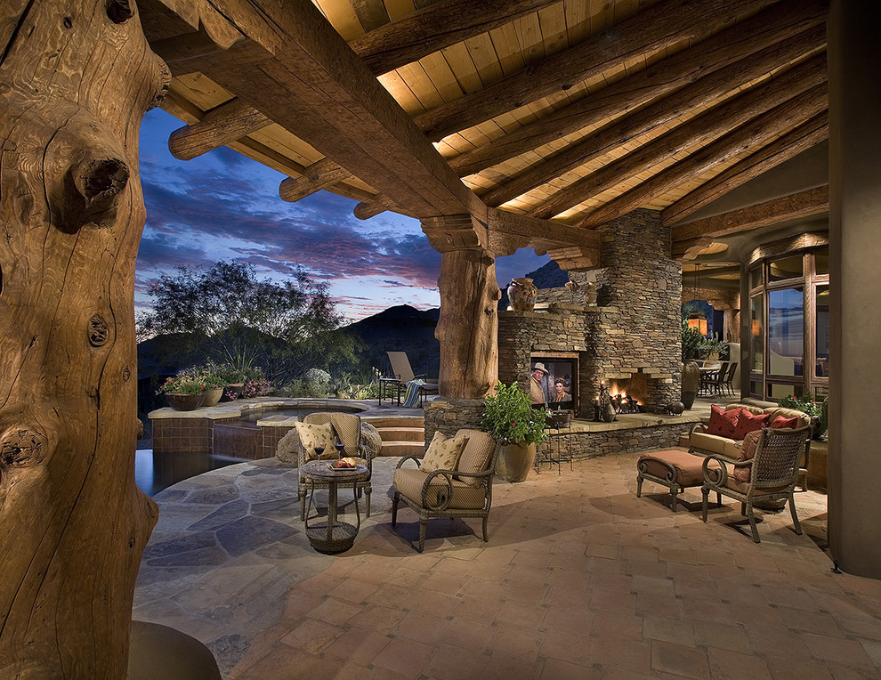 Example of a southwest patio design in Phoenix with a fire pit