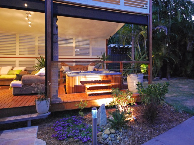Inspiration For A Tropical Backyard Patio Remodel In Dallas With Decking  And A Roof Extension