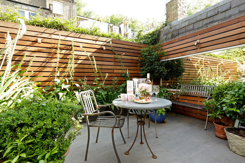 Inspiration for a small contemporary backyard concrete patio remodel in London with no cover
