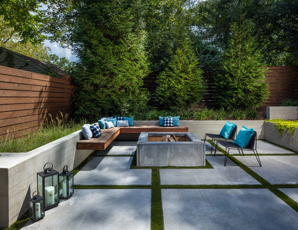 Patio - large contemporary backyard concrete patio idea in Atlanta with a fire pit and no cover