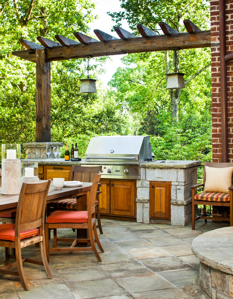 Patio kitchen - large transitional backyard concrete paver patio kitchen idea in Atlanta with a roof extension