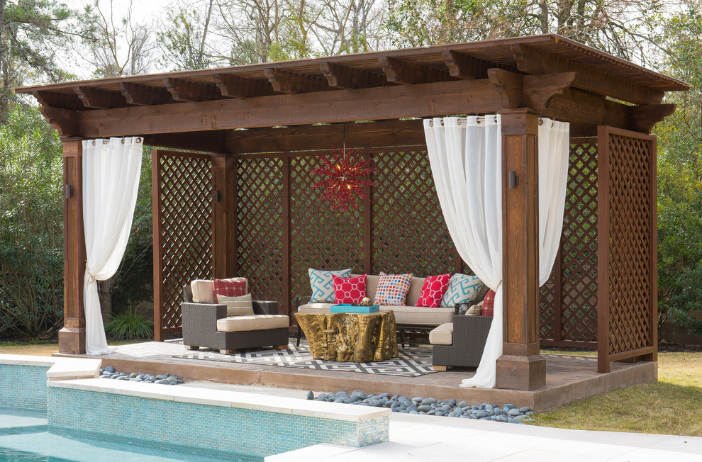 Mid-sized trendy backyard stamped concrete patio photo in Houston with a gazebo