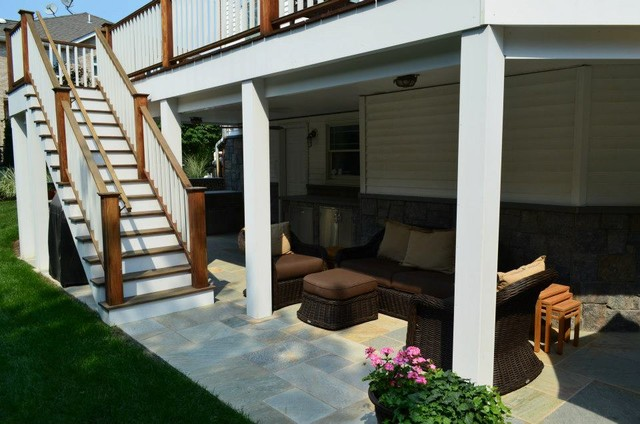 Outdoor living patio space beneath deck contemporary for Walkout basement patio ideas