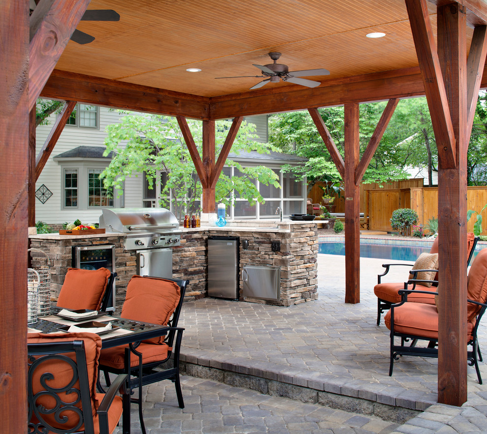 Patio kitchen - large traditional backyard brick patio kitchen idea in Charlotte with a gazebo
