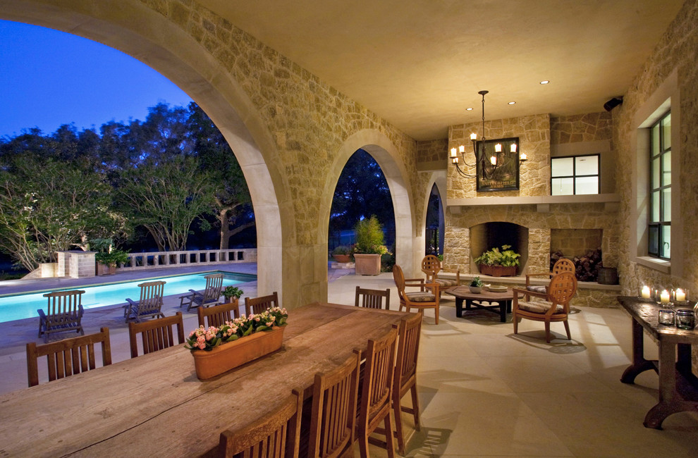 Inspiration for a large timeless backyard patio remodel in Austin with a fire pit and a roof extension
