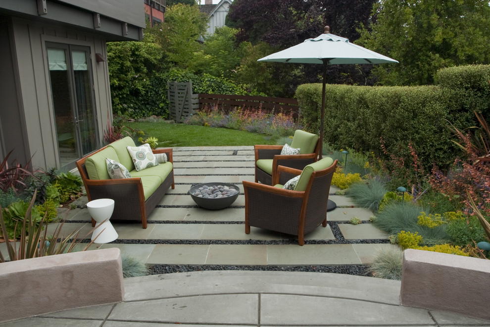 Patio - contemporary patio idea in San Francisco with a fire pit