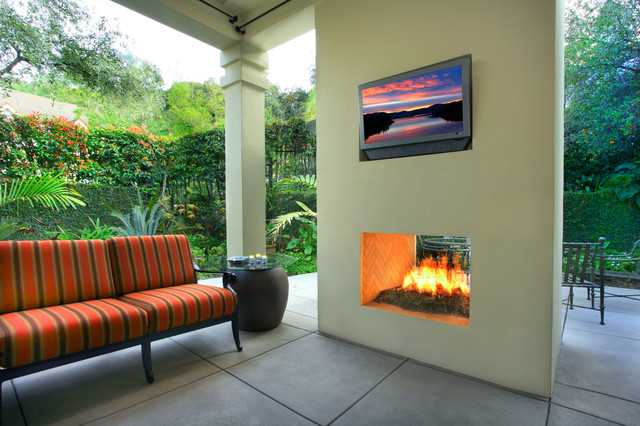 Outdoor modern two sided fireplace by designed by gary sewell jr tropical patio
