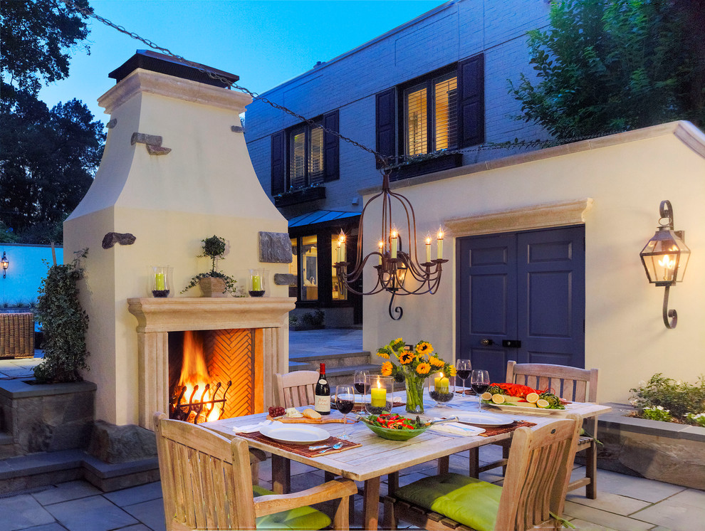 Patio - mediterranean patio idea in DC Metro with a fire pit
