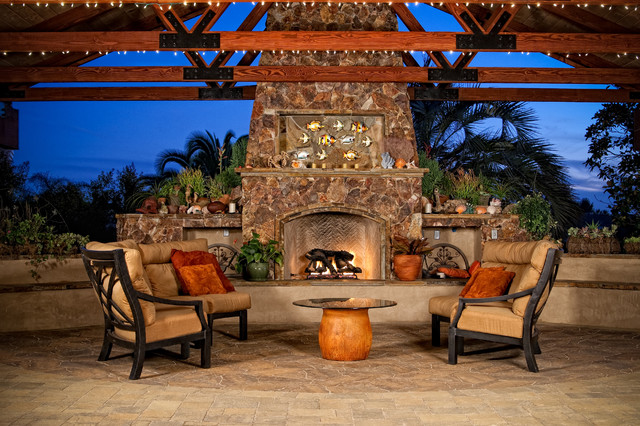 Outdoor patio cover with stone fireplace mediterranean-patio